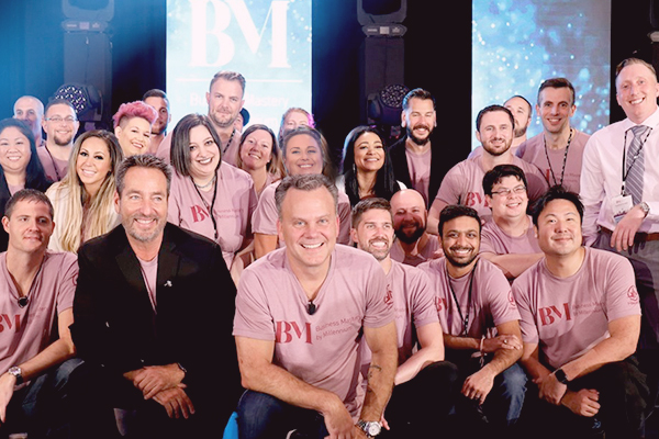 MSI Employees with Founder and CEO John Harms