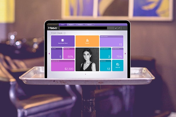 tablet with Meevo 2 featuring salon and spa software
